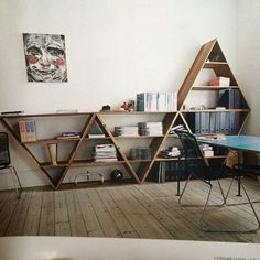 I love these triangular shelves. They are really unique and very architecturally different. They give kind of a cool hipster vibe, but are still mature and break up the lines of the room really nicely.