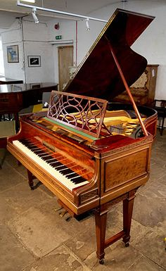 A 1910, Bluthner Grand Piano For Sale with a Chippendale Style Case at Besbrode Pianos. Cabinet Features Flame Mahogany Panels, Gate Legs and Elegant, Filigree Music Desk. Cabinet designed and made by Waring and Gillow. Waring & Gillow is a noted firm of English furniture manufacturers formed in 1897 by the merger of Gillow of Lancaster and Waring of Liverpool. Gillow's of Lancaster established a reputation for supplying high-quality furniture to the richest families in the country. ...