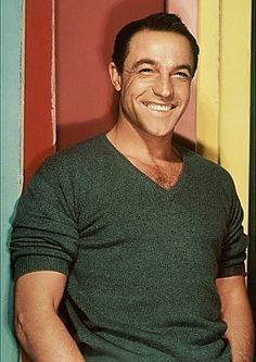 Gene Kelly...love a man in a v-neck sweater...who can dance & sing and still be masculine!