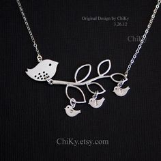Family bird initial necklace, birds on tree, mama bird and baby birds, leaf necklace, STERLING SILVER, family necklace, new baby shower. $39.00, via Etsy.