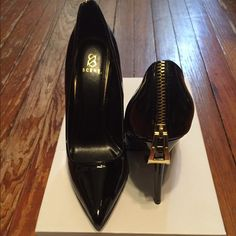 """Black patent """"Scene"""" pumps from ShoeDazzle. Gold zipper detail on back. Cushioned insole. Size 7, but they run a bit large. Worn once. Shoe Dazzle Shoes Heels"""