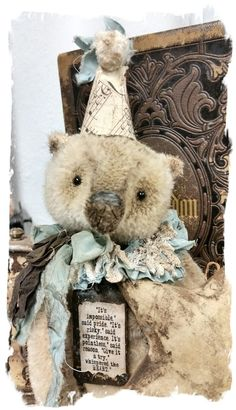 """A NEW MEDIUM SIZE --- Bear handmade by Wendy Meagher of Whendi's Bears - An Original ONE OF A KINDapprox 9.5"""" Tall (sits @ 7.5"""") - Antique Style - Vintage sparse short cream distressed mohair Bear with antique sheet music hat, ruff collar from antique textiles, handmade charm from antique salvage ceiling tin"""