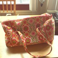 Vera Bradley Large Duffel Travel Bag This bag can fit so much and is flexible! Small hole ripped while going through airport security but is easily fixable! True deal!!! Vera Bradley Bags