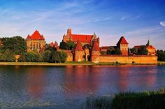 Castle of the Teutonic Order in Malbork is the largest castle in the world by surface area, and the largest brick building in Europe. It was built in 1406 in Prussia by the Teutonic Knights, a German Roman Catholic religious order of crusaders. The castle is a classic example of a medieval fortress.
