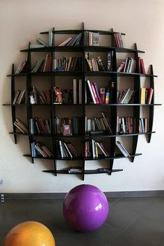 Round Shape Black Wood Creative Bookshelves On White Wall Color Dark Grey Floor At Delightful Study Room : Decorating Creative Bookshelves Ideas