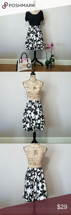 """CAbi Embroidered Skirt. CAbi Embroidered Skirt. Perfect for the office or a day out. Nice detailed embroidery on the hem and throughout the skirt. Color is black and off white. Washed once but never worn. Size 10. 100% Cotton. Measures approximately: Waist lying flat 16""""1/2 Length 22"""". Feel free to ask any questions before purchase. Bundle & Save. Offers welcome. CAbi Skirts"""