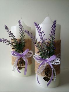 A solidarity candle is basically a candle used in a marriage experience to symbolize two people signing up with in relationship.White candles with lavender, burlap and ribbon bow, spring wedding decors see lots and lots of hand crafted, classic, as w Christmas Candle Decorations, Spring Wedding Decorations, Christmas Candles, Christmas Crafts, Purple Wedding Centerpieces, Candle Centerpieces, White Candles, Diy Candles, Lavender Candles