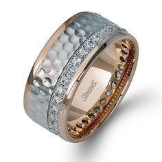 Men's Collection - This stunning 14K white and rose gold band is comprised of .64ctw round white Diamonds.  - LL119