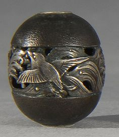 Lot 83: SILVER OJIME By Ichimasa. In seed form with pierced chidori and wave design. Length 16mm. - Eldred's | Invaluable
