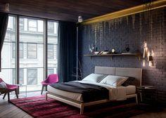 Chambre moderne avec fauteuil design fuchsia, tapis en camaïeu de rouge et  mur de briques noires rehaussé d'une coulée or sur la moulure