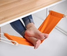 An under the desk foot hammock! oh my gosh i need this so much because my legs get irritated when they arent propped up