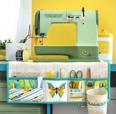 Undercover Maker Mat Tutorial - This dual purpose sewing space organizer has double pockets and a removable thread catcher to keep all your notions at hand and your workspace tidy. It goes from under to {machine} cover when not in use with side ties to keep it in place. ~lillyella stitchery