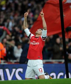 Olivier Giroud celebrates scoring a goal for Arsenal during the Barclays Premier League match between Arsenal and Southampton at Emirates Stadium on November 23, 2013