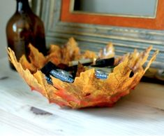 Make a bowl from leaves by Hello Lucky, featured @savedbyloves #Fall #DIY #Crafts
