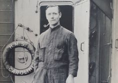 Chorley man Samuel Henry Cockroft on board HMS Caroline during World War One, taking a break on deck, smoking a pipe and dressed in an engineers' boiler suit. The message on the back of the photo reads: