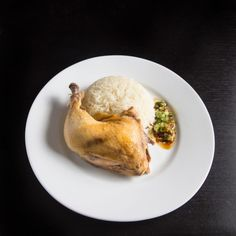 """Make this easy Singaporean Hainanese Chicken Rice recipe! Dip the tender & moist Hainanese chicken into flavorful sauces with a spoonful of fragrant """"oily rice"""". Comforting chicken and rice meal with a homey soup. A simple complete meal with almost zero waste!"""