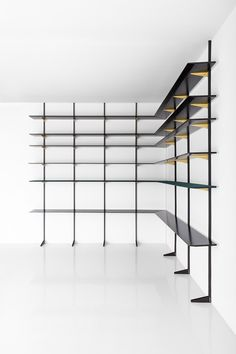 LIBRERIA 074DIMORESTUDIO, PROGETTO NON FINITO2012Modular shelving system with five wooden shelves, one shelf upholstered in felt. Brackets in oxidised brass and wall structure in matte black painted metal.w.286 x d.38 x h.350 cm (each module)