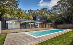 modscape conceals modular pool-side home in australia with rendered brick-wall