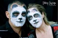 The only way you know it's not real pandas is because of the necks. | The Most Elaborate Face Painting In The World
