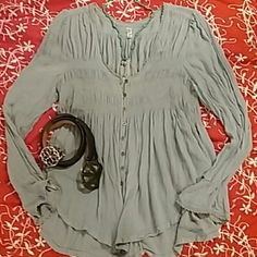 Free People Blue bird Tunic top FP Tunic top faded blue color NWOT. Size Medium. Never worn just tried on. My hair is blue so this was too much blue. Free People Tops Tunics