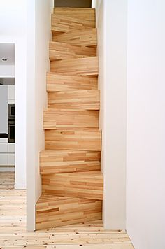 This is a low budget project made out of stacked boxes of pine. The cut out between the ground floor and the attic was to narrow to construct a regular stair. We had to put each step angled to get the right amount and height of them. It is well-functional and exciting to walk cause of the extra steepness. http://www.tafarkitektkontor.se