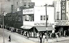 """Movie theaters.  Long line of movie-goers bends around the corner in Royal Oak, MI, waiting to buy tickets for a double feature,  """"Captain Kidd"""" and """"Brewster's Millions"""" which would make it 1945...pre-television...and just slightly before my time."""