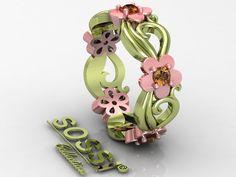 Este hermoso anillo de compromiso de dos tonos verde y oro rosa con cinco diamantes champán alrededor del anillo .. Diferente? Sí, este anillo es bastante único y sorprendente que usar! DE SOSSI JOYERÍA DISEÑOS PERSONALIZADOS LA CANADA, CA