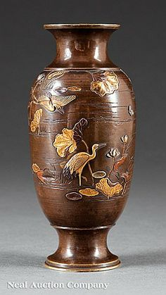 A Japanese Bronze and Mixed Metal Vase, Meiji Period (1868-1912), ovoid body with waisted neck and foot, relief decorated with cranes wading in a lotus pond, height 5 3/4 in