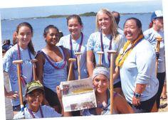 La ra Sharfin and the canoe paddling club enjoying The Taos News before they paddle away in O'ahu Honolulu Hawaii.