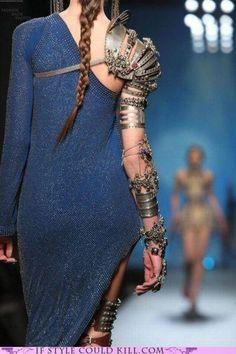The dress not so much, but that arm piece is baddddddddd