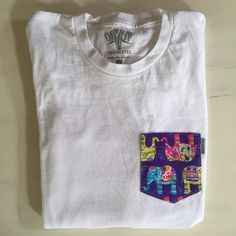 Serengetee long sleeve tee with elephant pocket Serengetee long sleeve tee with elephant pocket. Tiny spot on the right arm sleeve but you can hardly even see it in the picture Tops Tees - Long Sleeve