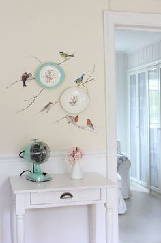 Wall plates are surrounded with stenciled birds on branches. #coachbarn #design