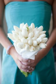 White tulips for bridesmaid with colored dresses and colored tulips for the bride with a white dress.