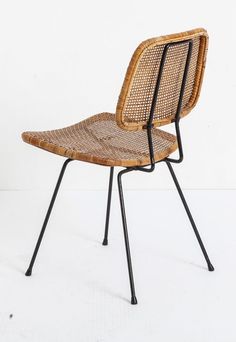 cane back chair with black iron legs