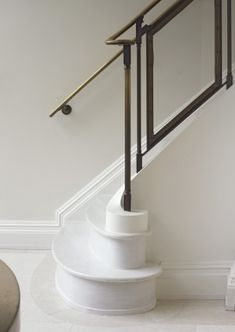 glass and aged brass railing; curlicue steps
