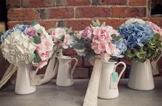 bridesmiads bouquets in jugs - pink blue green hydranges roses. See more of our floral designs at www.passionforflowers.net. Voted Best Wedding Florist in ENGLAND in The Wedding Industry Awards.