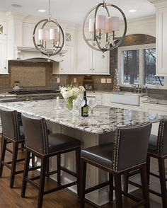 We're not sure who designed this kitchen but they sure did a beautiful job!