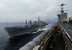 EVERYDAY LIFE ON AN AIR CRAFT CARRIER - SUPPLY TENDER ALONG SIDE