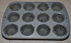 Biodegradable seed pots made from newspaper molded in muffin tins.