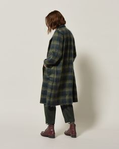 Scottish-woven wool mohair plaid. Straight cut. Set-in sleeves. Polished imitation horn buttons - the top button showing, the rest concealed beneath placket. Deep patch pockets.