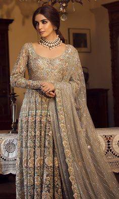 Grey Color Wedding Anarkali Gown This Anarkali Gown is in georgette silk embellished with silk threads, beads, stones. Dupatta is in georgette fabric with mukaish work with scallop edges. For customisation please contact our sales team through WhatsApp Beautiful Bridal Dresses, Desi Wedding Dresses, Asian Wedding Dress, Pakistani Wedding Outfits, Indian Bridal Outfits, Indian Bridal Fashion, Pakistani Bridal Dresses, Indian Fashion Dresses, Wedding Gowns