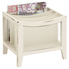 The perfect addition to your powder room or den, this wood magazine rack features 3 storage compartments and meshed paneling.  Produ...  70