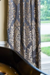 gold damask on a grey-blue fabric