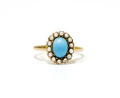 Vintage Ring with Turquoise and Pearl Stones Stunning 14K gold vintage ring accented with large center turquoise stone and seed pearls. Approximately size 7.  $225.00