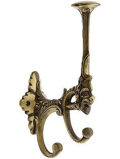 This romantic Victorian triple coat hook features a mythical laughing face incorporated into the design. Especially suitable for Victorian and romantic interiors, this solid brass is available in two finishes. Shelf Hooks, Hat Hooks, Shelves, Antique Hardware, Antique Brass, Laughing Face, Brass Patina, Brass Hook, Dream Bathrooms