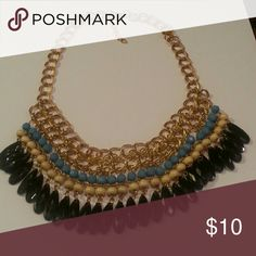 "Gold tone statement necklace Has black, cream and blue accents. The necklace is 16"" and 2"" extender. Jewelry Necklaces"