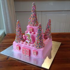 Girls 3rd birthday princess castle cake. Inspired by Betty Crocker tutorial - my cakes are cut a little differently to suit my cake tins & recipe. Vanilla butter cake with vanilla shortening frosting (was expecting a hot day). So much fun to make, and simple (just time consuming). Everyone loved it!