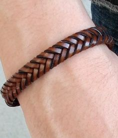 He wore a bracelet of braided leather on his right wrist – Page 32 Lines 2-3