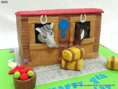 Fun childrens pony in a stable shaped cake with a couple of ponies looking out over the stable doors, complete with bale of hay and bucket of apples http://www.cakescrazy.co.uk/details/pony-in-the-stable-cake-9559.html