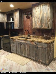 A little barnwood kitchen cabinets and corrugated steel backsplash. Love how rustic and homey it is! A little barnwood kitchen cabinets and corrugated steel backsplash. Love how rustic and homey it is! Cabin In The Woods, Farmhouse Kitchen Cabinets, Rustic Cabinets, Island Kitchen, Pantry Cabinets, Kitchen Backsplash, Medicine Cabinets, Wall Cabinets, White Cabinets